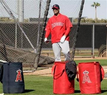 Los Angeles Angels' Albert Pujols walks out of the batting cage during a baseball spring training workout Monday, Feb. 20, 2012, in Tempe, Ariz. (AP Photo/Morry Gash) By Morry Gash