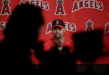 Los Angeles Angels' Albert Pujols answers a question during a news conference after a spring training baseball workout, Monday, Feb. 20, 2012, in Tempe, Ariz. (AP Photo/Morry Gash) By Morry Gash