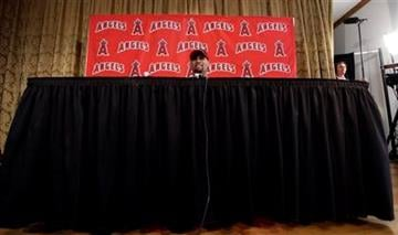 Los Angeles Angels' Albert Pujols answers a question during a news conference after a spring training baseball workout Monday, Feb. 20, 2012, in Tempe, Ariz. (AP Photo/Morry Gash) By Morry Gash