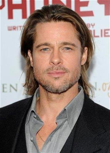"""Actor Brad Pitt attends the premiere of """"In The Land of Blood and Honey"""" at The School of Visual Arts Theater on Monday, Dec. 5, 2011 in New York. (AP Photo/Evan Agostini) By Evan Agostini"""