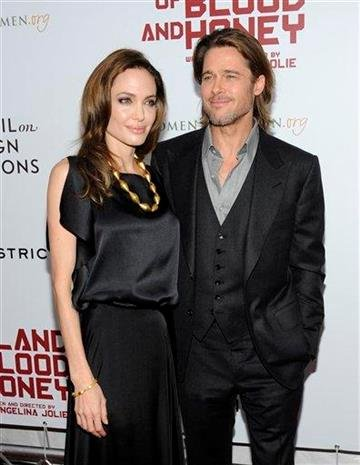 """Writer and director Angelina Jolie and husband actor Brad Pitt attend the premiere of """"In The Land of Blood and Honey"""" at The School of Visual Arts Theater on Monday, Dec. 5, 2011 in New York. (AP Photo/Evan Agostini) By Evan Agostini"""