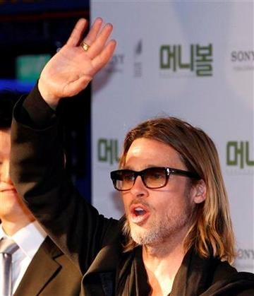 """Actor Brad Pitt waves after the red carpet for his latest film """"Moneyball"""" in Seoul, South Korea, Tuesday, Nov. 15, 2011. (AP Photo/Lee Jin-man) By Lee Jin-man"""