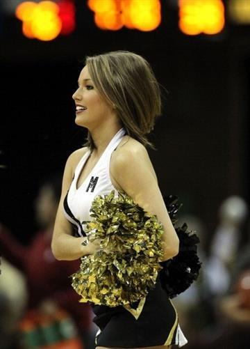 COLUMBIA, MO - JANUARY 03:  A Missouri Tigers cheerleader performs during the game against the Oklahoma Sooners on January 3, 2012 at Mizzou Arena in Columbia, Missouri.  (Photo by Jamie Squire/Getty Images) By Jamie Squire