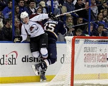 Colorado Avalanche's Tyson Barrie (41) slams into St. Louis Blues' Jamie Langenbrunner (15) along the boards in the second period of an NHL hockey game, Saturday, Feb. 11, 2012 in St. Louis.(AP Photo/Tom Gannam) By Tom Gannam