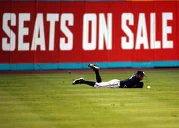 MIAMI GARDENS, FL - JUNE 04:  Nyjer Morgan #2 of the Milwaukee Brewers cannot make a catch against the Florida Marlins at Sun Life Stadium on June 4, 2011 in Miami Gardens, Florida.  (Photo by Marc Serota/Getty Images) By Marc Serota