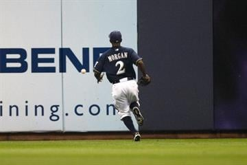 MILWAUKEE, WI - JUNE 8: Nyjer Morgan #2 of the Milwaukee Brewers plays the baseball off the wall against the New York Mets at Miller Park on June 8, 2011 in Milwaukee, Wisconsin. (Photo by Scott Boehm/Getty Images) By Scott Boehm