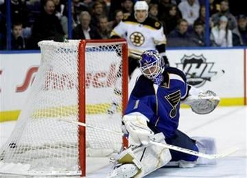 St. Louis Blues goalie Brian Elliott (1) watches a shot by Boston Bruins' Chris Kelly fly into the net during the first period of an NHL hockey game, Wednesday, Feb. 22, 2012, in St. Louis. (AP Photo/Tom Gannam) By Tom Gannam