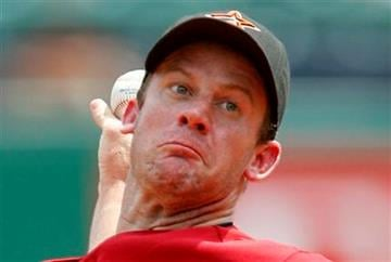 Houston Astros pitcher Roy Oswalt throws in the first inning during a baseball game against the Pittsburgh Pirates in Pittsburgh on Sunday, July 18, 2010. (AP Photo/Gene J. Puskar) By Gene J. Puskar