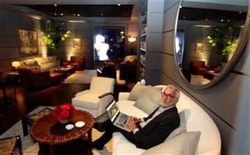Interior designer Waldo Fernandez poses for a picture in the greenroom for the 84th Annual Academy Awards at the Kodak Theatre in Los Angeles, Thursday, Feb. 23, 2012. The Academy Awards will be held on Sunday.(AP Photo/Chris Carlson) By Chris Carlson