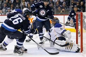 Winnipeg Jets' Blake Wheeler (26) scores past St. Louis Blues' goaltender Jaroslav Halak (41)  during second period NHL hockey action in Winnipeg, Manitoba, on Saturday, Feb. 25, 2012. (AP Photo/The Canadian Press, John Woods) By John Woods