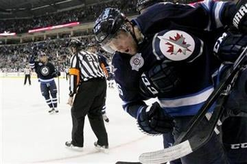 Winnipeg Jets' Blake Wheeler (26) celebrates his second goal agains the St. Louis Blues during second period NHL hockey action in Winnipeg, Manitoba, on Saturday, Feb. 25, 2012. (AP Photo/The Canadian Press, John Woods) By JOHN WOODS