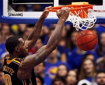 Missouri forward Ricardo Ratliffe (10) dunks during the first half of an NCAA college basketball game against Kansas in Lawrence, Kan., Saturday, Feb. 25, 2012. (AP Photo/Orlin Wagner) By Orlin Wagner