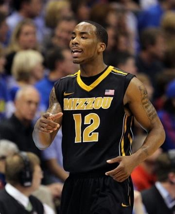 LAWRENCE, KS - FEBRUARY 25:  Marcus Denmon #12 of the Missouri Tigers reacts after scoring during the game against the Kansas Jayhawks on February 25, 2012 at Allen Fieldhouse in Lawrence, Kansas.  (Photo by Jamie Squire/Getty Images) By Jamie Squire