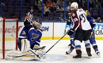 St. Louis Blues goalie Ben Bishop, left, deflects a shot as Colorado Avalanche's Daniel Winnik (34) looks on during the first period of a preseason NHL hockey game on Thursday, Sept. 29, 2011, in St. Louis. (AP Photo/Jeff Roberson) By Jeff Roberson
