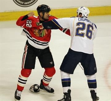 CHICAGO, IL - MARCH 13: Jamal Mayers #22 of the Chicago Blackhawks fights with B.J. Crombeen #26 of the St. Louis Blues at the United Center on March 13, 2012 in Chicago, Illinois. (Photo by Jonathan Daniel/Getty Images) By Jonathan Daniel