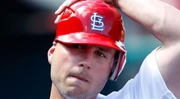 Matt Holliday #7 of the St. Louis Cardinals looks on from the dugout during a game against the Houston Astros at Roger Dean Stadium on March 14, 2012 in Jupiter, Florida.  (Photo by Sarah Glenn/Getty Images) By Sarah Glenn