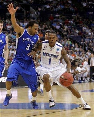Memphis' Joe Jackson, right, drives to the basket as Saint Louis' Kwamain Mitchell defends during the first half of an NCAA college basketball tournament second-round game on Friday, March 16, 2012, in Columbus, Ohio. (AP Photo/Jay LaPrete) By Jay LaPrete