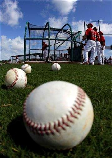 Members of the St. Louis Cardinals warm up before a spring training baseball game against the Miami Marlins in Jupiter, Fla., Friday, March 16, 2012. (AP Photo/Patrick Semansky) By Patrick Semansky