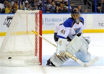 St. Louis Blues goalie Jaroslav Halak, of Slovakia, deflects a shot on goal by the Tampa Bay Lighting during the second period of an NHL hockey game, Saturday, March 17, 2012, in Tampa, Fla. (AP Photo/Brian Blanco) By Brian Blanco