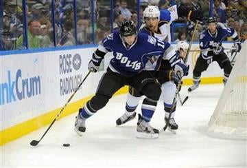Tampa Bay Lightning left wing Tom Pyatt, left, controls the puck in front of St. Louis Blues defenseman Alex Pietrangelo during the second period of an NHL hockey game, Saturday, March 17, 2012, in Tampa, Fla. (AP Photo/Brian Blanco) By Brian Blanco