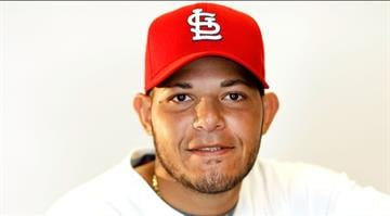 JUPITER, FL - FEBRUARY 29:  Yadier Molina #4 of the St. Louis Cardinals poses during photo day at Roger Dean Stadium on February 29, 2012 in Jupiter, Florida.  (Photo by Mike Ehrmann/Getty Images) By Mike Ehrmann