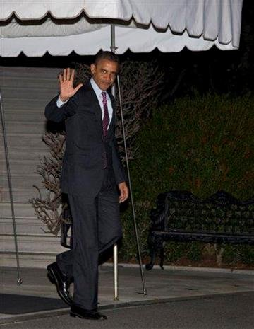 President Barack Obama waves to media as he walks from the White House to board Marine One, Friday, March 23, 2012, in Washington, as he travels to Seoul, Republic of Korea. (AP Photo/Carolyn Kaster) By Carolyn Kaster
