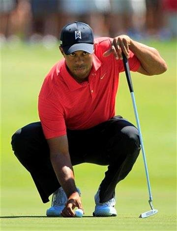 Tiger Woods lines up a putt on the second green during the final round of the Arnold Palmer Invitational golf tournament at Bay Hill, Sunday, March 25, 2012, in Orlando, Fla. (AP Photo/John Raoux) By John Raoux