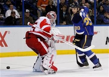 Detroit Red Wings goalie Jimmy Howard, left, deflects the puck as St. Louis Blues' Alexander Steen looks on during the second period of an NHL hockey game Tuesday, Nov. 15, 2011, in St. Louis. (AP Photo/Jeff Roberson) By Jeff Roberson
