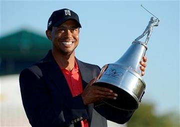 Tiger Woods hoists the championship trophy after winning the Arnold Palmer Invitational golf tournament at Bay Hill in Orlando, Fla., Sunday, March 25, 2012. (AP Photo/Phelan M. Ebenhack) By Phelan M. Ebenhack