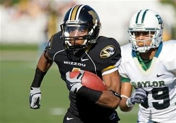 Missouri's Jared Perry, left, runs away from Baylor's Chance Casey, right, after catching a pass during the first quarter of an NCAA college football game Saturday, Nov. 7, 2009, in Columbia, Mo.  (AP Photo/L.G. Patterson) By L.G. Patterson