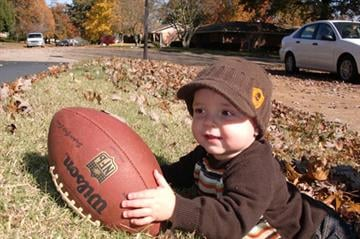 Jude playing football By Afton Spriggs
