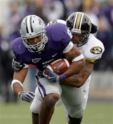 Kansas State running back Daniel Thomas (8) is brought down by Missouri defensive end Brian Coulter during the second quarter of an NCAA college football game Saturday, Nov. 14, 2009 in Manhattan, Kan. (AP Photo/Charlie Riedel) By Charlie Riedel
