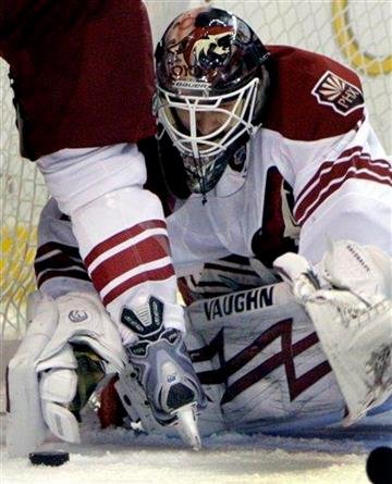 Phoenix Coyotes goalie Ilya Bryzgalov, of Russia, reaches for a loose puck in front of the net during the second period of an NHL hockey game against the St. Louis Blues on Thursday, Nov. 19, 2009, in St. Louis. (AP Photo/Jeff Roberson) By Jeff Roberson