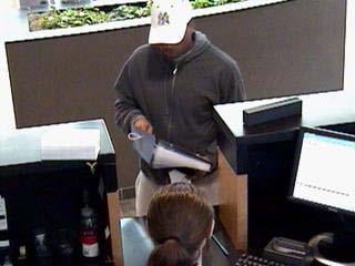 Security camera images of the suspect that robbed the Commerce Bank at 8050 Big Bend in Webster Groves. By Bryce Moore