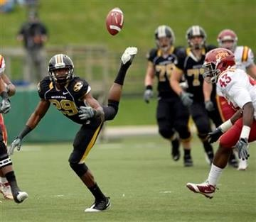 Missouri wide receiver Jerrell Jackson, left, drops a pass as Iowa State's Fred Garrin, right, defends during the first half of an NCAA college football game Saturday, Nov. 21, 2009, in Columbia, Mo.  (AP Photo/L.G. Patterson) By L.G. Patterson