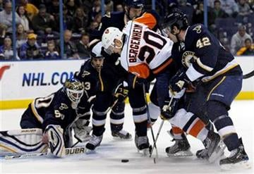 New York Islanders' Sean Bergenheim (20) battles St. Louis Blues' David Backes (42) for the loose puck in front of goalie Chris Mason in the first period of an NHL hockey game, Saturday, Nov. 21, 2009, in St. Louis.(AP Photo/Tom Gannam) By Tom Gannam