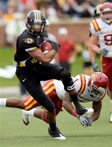 Missouri wide receiver Danario Alexander, left, slips past Iowa State's David Sims, right, after a reception during the first half of an NCAA college football game Saturday, Nov. 21, 2009, in Columbia, Mo.  (AP Photo/L.G. Patterson) By L.G. Patterson