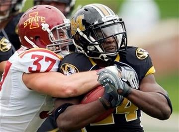 Missouri running back Derrick Washington, right, is tackled by Iowa State's Michael O'Connell, left, during the first half of an NCAA college football game Saturday, Nov. 21, 2009, in Columbia, Mo.  (AP Photo/L.G. Patterson) By L.G. Patterson