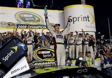 Jimmie Johnson celebrates after winning the NASCAR Sprint Cup Series season championship, at Homestead-Miami Speedway in Homestead, Fla., Sunday, Nov. 22, 2009. (AP Photo/Chuck Burton) By Chuck Burton
