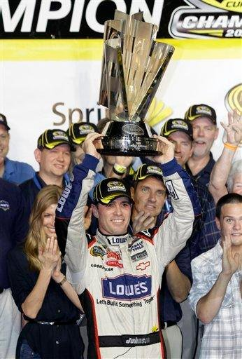 Jimmie Johnson raises the trophy after winning the NASCAR Sprint Cup season championship, at Homestead-Miami Speedway in Homestead, Fla., Sunday, Nov. 22, 2009. (AP Photo/Terry Renna) By Terry Renna
