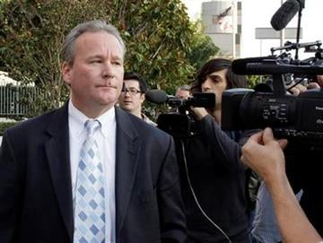 Michael Barrett, accused of secretly making nude videos of ESPN reporter Erin Andrews, leaves after his appearance in federal court in Los Angeles on Friday, Nov. 20, 2009.  (AP Photo/Reed Saxon) By Reed Saxon