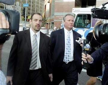 Michael Barrett, right, accused of secretly making nude videos of ESPN reporter Erin Andrews, and attorney David Willingham leave after Barrett's appearance in federal court in Los Angeles Friday, Nov. 20, 2009.  (AP Photo/Reed Saxon) By Reed Saxon