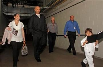 St. Louis Cardinals Albert Pujols, center, walks to a baseball news conference to announce his third National League MVP award with his wife Diedre, left, and his daughter Sophia on Tuesday, Nov. 24, 2009 in St. Louis.(AP Photo/Tom Gannam) By Tom Gannam