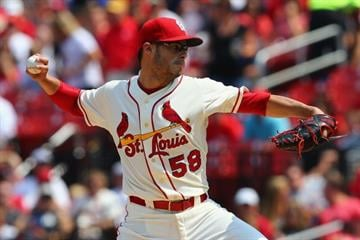 ST. LOUIS, MO - JULY 19: Starter Joe Kelly #58 of the St. Louis Cardinals pitches against the Los Angeles Dodgers in the first inning at Busch Stadium on July 19, 2014 in St. Louis, Missouri.  (Photo by Dilip Vishwanat/Getty Images) By Dilip Vishwanat
