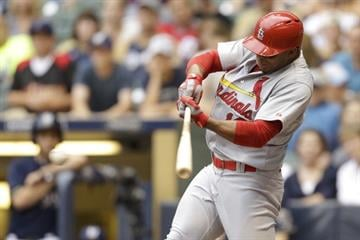 MILWAUKEE, WI - JULY 12: Kolten Wong #16 of the St. Louis Cardinals hits a single in the top of the fifth inning against the Milwaukee Brewers at Miller Park on July 12, 2014 in Milwaukee, Wisconsin. (Photo by Mike McGinnis/Getty Images) By Mike McGinnis