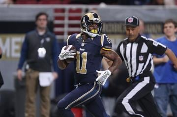 St. Louis Rams Tavon Austin looks around for a defender as he takes the football  65 yards for a touchdown in the first quarter against the Chicago Bears at the Edward Jones Dome in St. Louis on November 24, 2013. UPI/Bill Greenblatt By BILL GREENBLATT