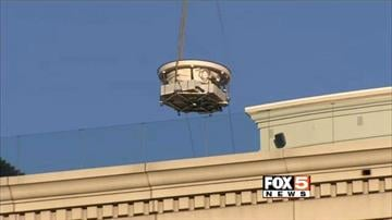 A helicopter hoisted and placed a custom-made hot tub atop the Nobu tower at Caesars Palace on July 21, 2014. By Daniel Fredman