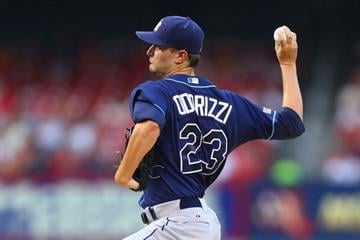 ST. LOUIS, MO - JULY 22: Starter Jake Odorizzi #23 of the Tampa Bay Rays pitches against the St. Louis Cardinals in the first inning at Busch Stadium on July 22, 2014 in St. Louis, Missouri.  (Photo by Dilip Vishwanat/Getty Images) By Dilip Vishwanat