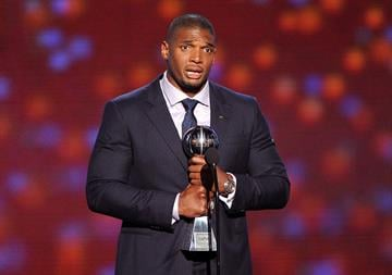LOS ANGELES, CA - JULY 16:  NFL player Michael Sam accepts the Arthur Ashe Courage Award onstage during the 2014 ESPYS at Nokia Theatre L.A. Live on July 16, 2014 in Los Angeles, California.  (Photo by Kevin Winter/Getty Images) By Kevin Winter
