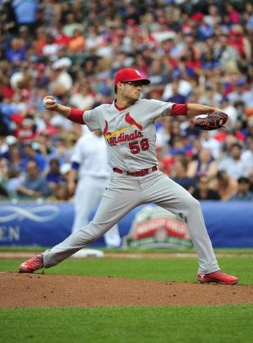 CHICAGO, IL - JULY 25: Joe Kelly #58 of the St. Louis Cardinals pitches against the Chicago Cubs during the first inning on July 25, 2014 at Wrigley Field in Chicago, Illinois. (Photo by David Banks/Getty Images) By David Banks
